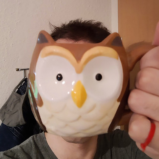 Picture of me and my favorite mug
